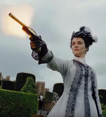 Sarah firing a gun