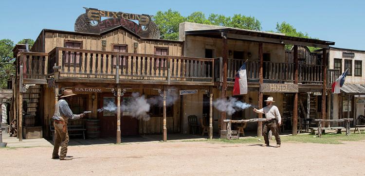 Two gunslingers fire away
