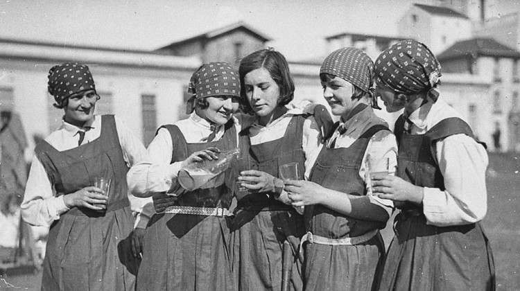 Five schoolgirls enjoy a glass of lemonade