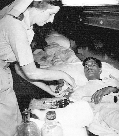 Sister L Hood of Auckland, New Zealand, bandaging Subadar Khanda Delvi, c1944: via National Army Museum