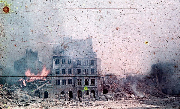 Rare Agfacolor photo taken in Warsaw in the Old Town Market Place (Zakrzewski's Side) during the Warsaw Uprising by Ewa Faryaszewska, August 1944